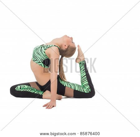 Image of flexible young woman doing gymnastic ring