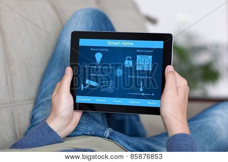 Man Holding Tablet With Program Smart Home On The Screen