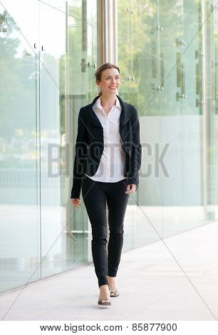 Happy Business Woman Walking Outside Office Building