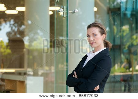 Serious Business Woman Standing Outside With Arms Crossed