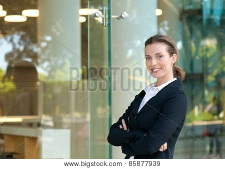 Confident Business Woman Smiling By Glass Window