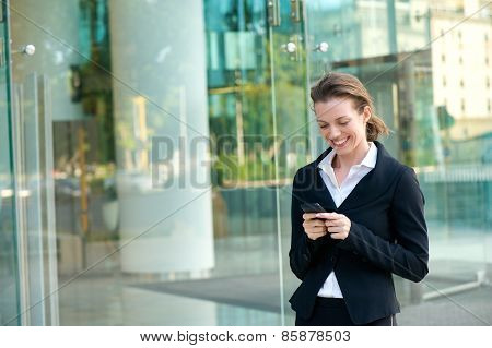 Happy Business Woman Reading Text Message On Mobile Phone