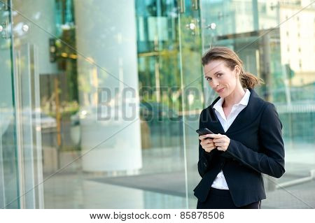 Attractive Business Woman Walking Outside With Mobile Phone