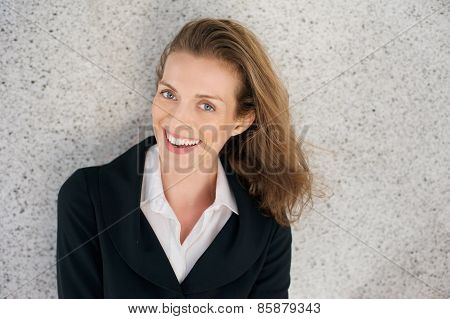 Business Woman Laughing With Black Jacket And White Shirt