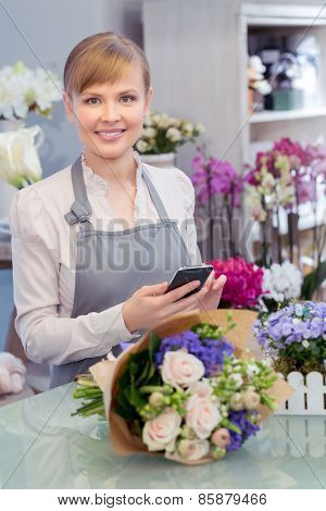 Florist with the phone in her hands