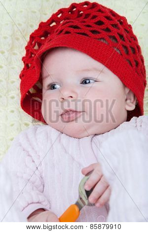 Portrait Baby Girl In Red Cap