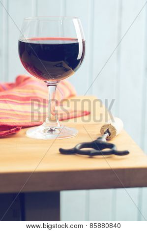 glass of red wine on kitchen table