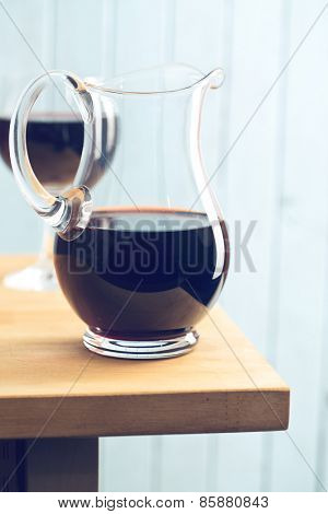 pitcher of red wine on kitchen table