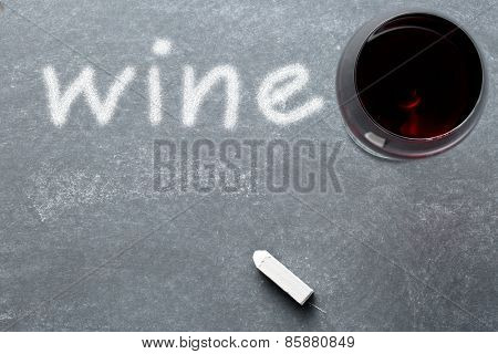 top view of glass of wine on chalkboard