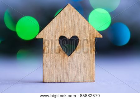 Wooden House With Hole In The Form Of Heart On Bokeh Background