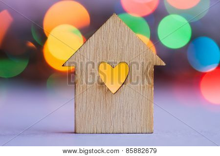 Wooden House With Hole In The Form Of Heart On Colorful Bokeh Background