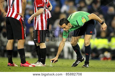 BARCELONA - MAR, 4: Referee Juan Martinez Munuera marks kick off positions with a Vanishing spray during a Spanish League match at the Estadi Cornella on March 4, 2015 in Barcelona, Spain