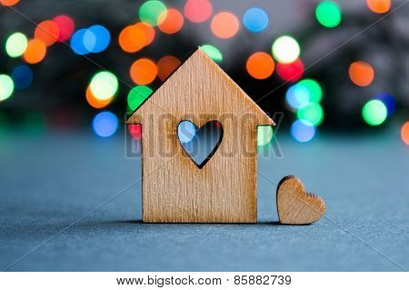Wooden House With Hole In The Form Of Heart With Little Heart On Colorful Bokeh Background