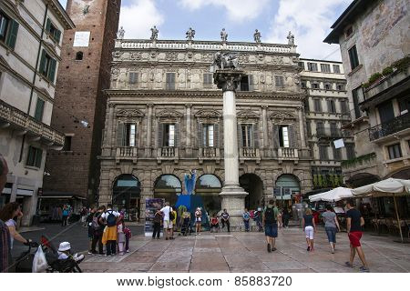 Saint Marco Lion Statue And Square Del Erbe In Verona