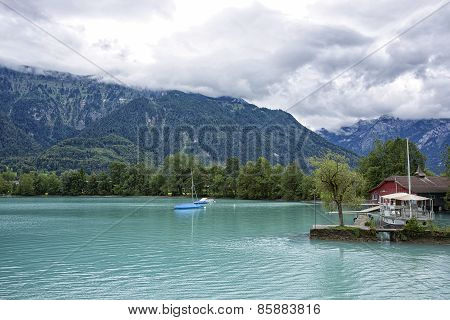 View To Boats Near Shores Of Brienz Lake
