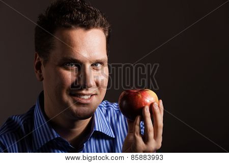 Diet Nutrition. Happy Man Holding Apple Fruit