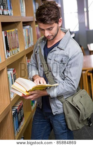 Student reading in library at the university