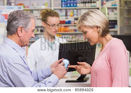 Costumers talking about medicine at pharmacy