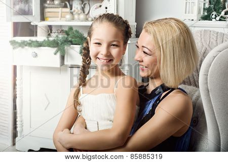 Portrait of laughing  mother and daughter