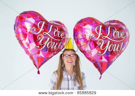 Geeky hipster holding balloons on white background