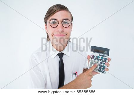 Geeky smiling businessman showing calculator on white background