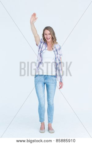 Pretty hipster waving on white background