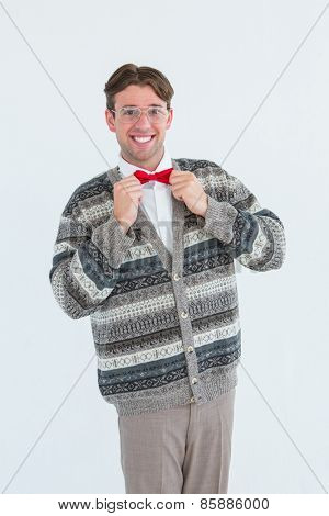 Happy geeky hipster with wool jacket on white background