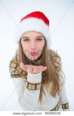 Happy hipster blowing kiss on white background