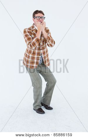 Geeky hipster looking nervous on white background