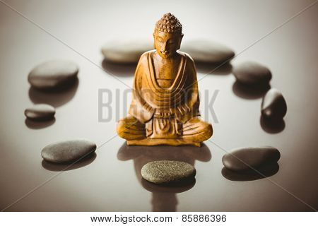 Buddha statue with stone circle shot in studio
