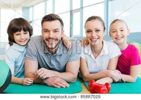 Happy Family In Fitness Club.