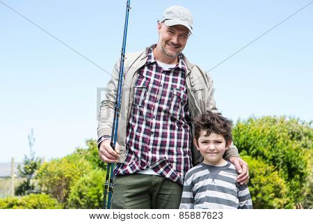 Father and son looking at camera in the countryside