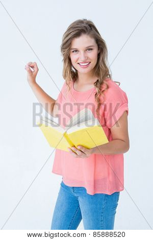 Hipster woman holding book on white background