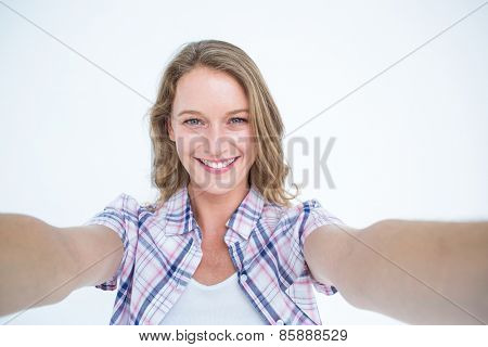 Happy hipster smiling at camera on white background