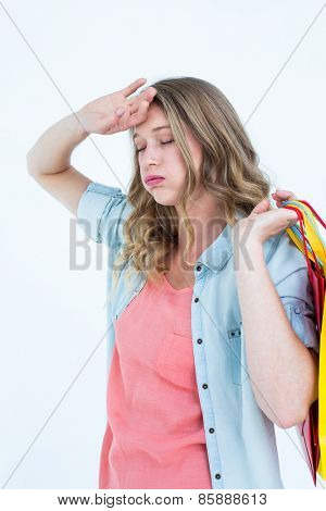 Woman holding some shopping bags on white background