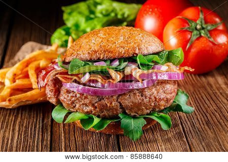 Burger With Bacon And French Fries Close Up.