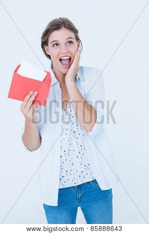 Smiling woman reading letter on white background