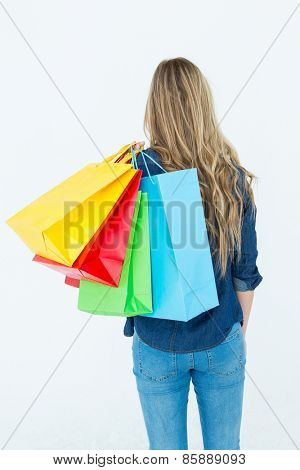 Woman holding shopping bags on white background