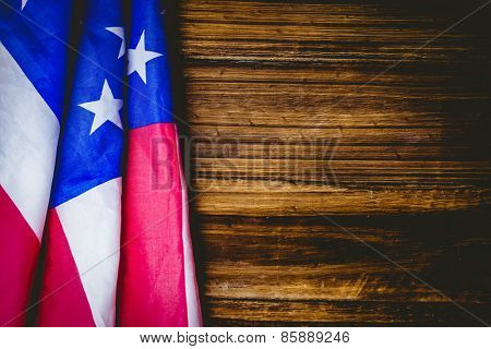 American flag on wooden table shot in studio