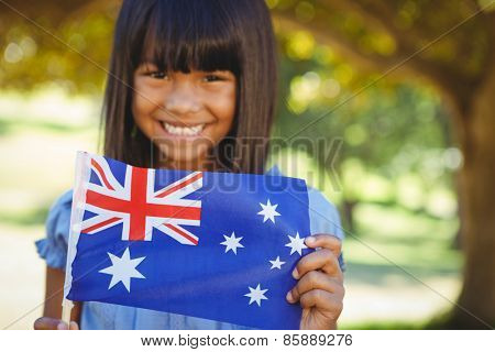 Cute little girl with australian flag on a sunny day