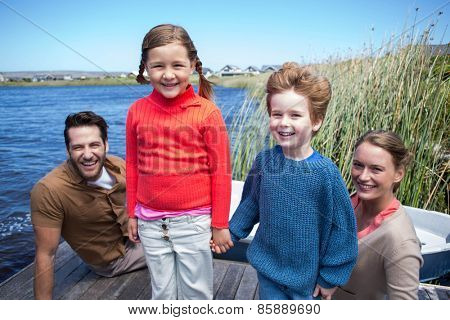 Happy family at a lake in the countryside