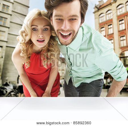 Couple with shopping bags walk