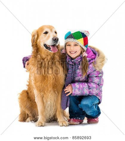 Smiling little girl with a golden retriever isolated on a white background