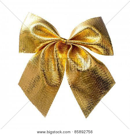 Gold Christmas bow close up isolated on a white background