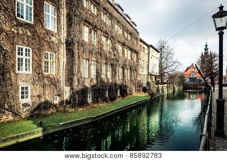 canal and old historic buildings in the old town of Gdansk, Poland