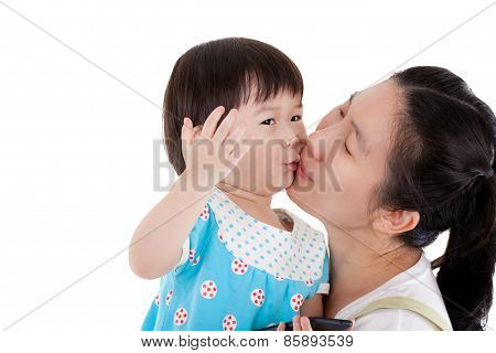 Asian Mother Carrying And Smooching Her Daughter On White Background