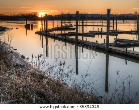 River Dock At Sunset