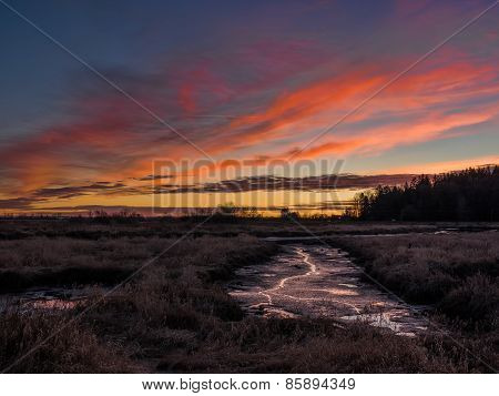 Orange Sunset Over River Bed