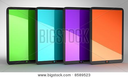 Group Of Four Tablets Pcs With Colored Displays