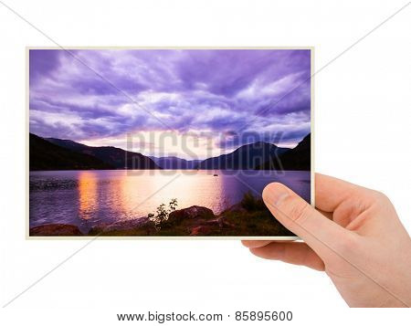 Norway travel photography in hand (my photo) isolated on white background